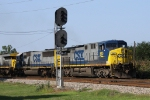 CSX 540 leads 7 other units across Evans Street
