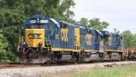 CSX 2293 leads a work train towards a meet with Q410