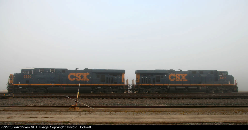 CSX 5250 & 5247 sit in the yard in the fog