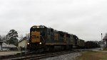 CSX 5973 leads train F713 northbound on a dreary, gray afternoon