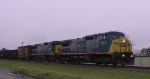 CSX 7844 & 7619 lead a southbound train in a light drizzle