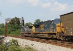 CSX 7911 leads train Q438-29 towards the signals at Contentnea Jct