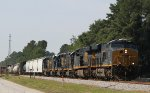 CSX 3062 leads another big GE unit and two road slug set northbound