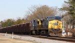 CSX 10 leads train F018-08 through town
