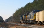 CSX 561 leads a southbound train towards the signals