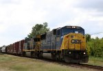 CSX 8725 leads a mixed freight train northbound