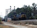 CSX 7814 leads a work train northbound