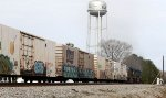 Train Q740-01 heads north, passing the water tower