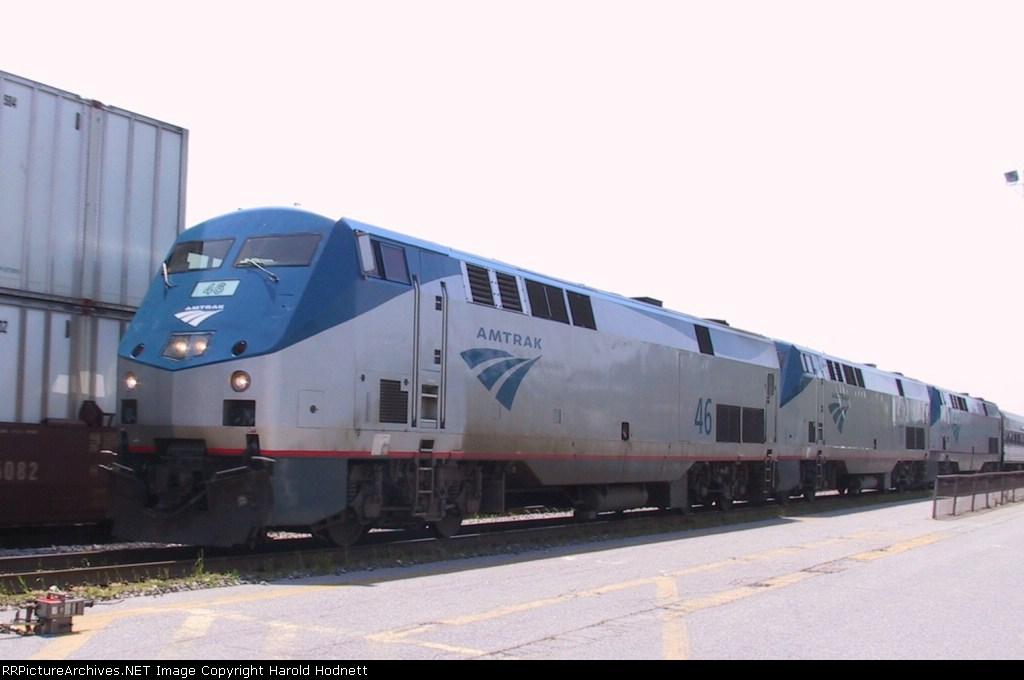 AMTK 46, 11, & 51 lead a train away from Pomona Station