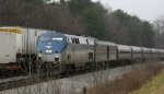 AMTK 150 leads Amtrak train 80, the Carolinian, past NS train 213