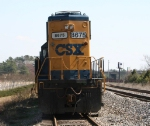CSX 8675 displays its new paint scheme as it holds down the siding with a work train