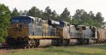CSX 773 heads up a grain train in the siding