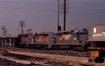 SBD 1239 leads a northbound piggyback train across Peace Street