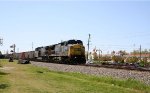 CSX 7395 leads a train past the NC State Fairgrounds