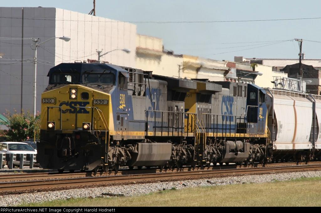 CSX 530 leads train G990-26 through town