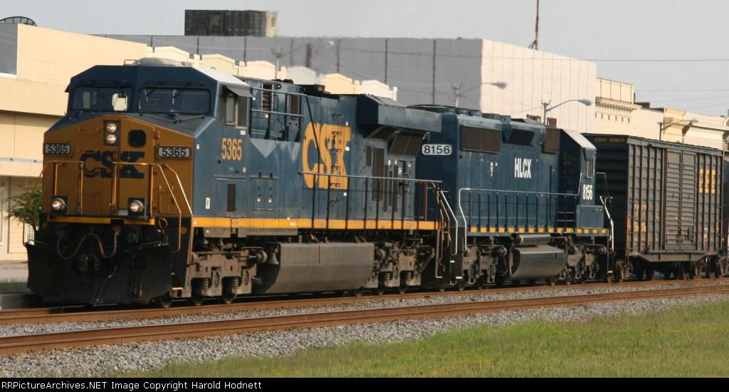 CSX 5365 & HLCX 8156 brings a Q train into town