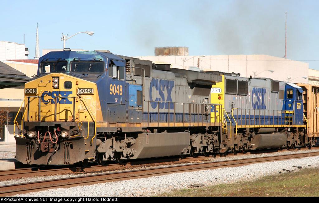 CSX 9048 leads a train southbound