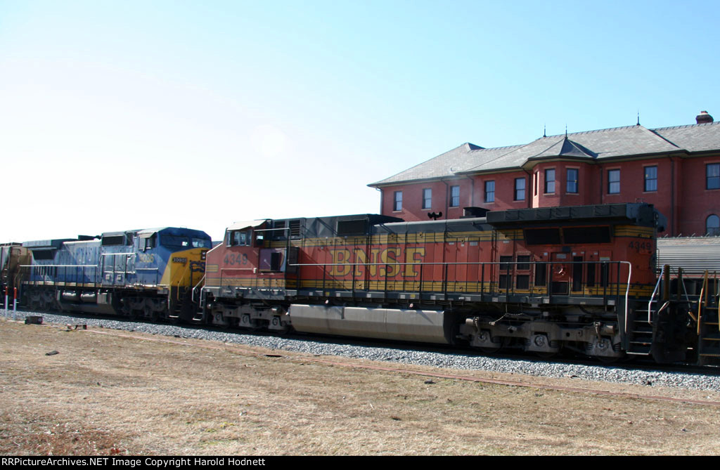 BNSF 4349 & CSX 9036 head northbound on an empty grain train