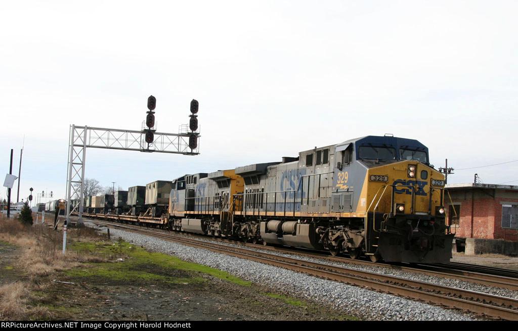 CSX 329 & 74 lead a military train northbound