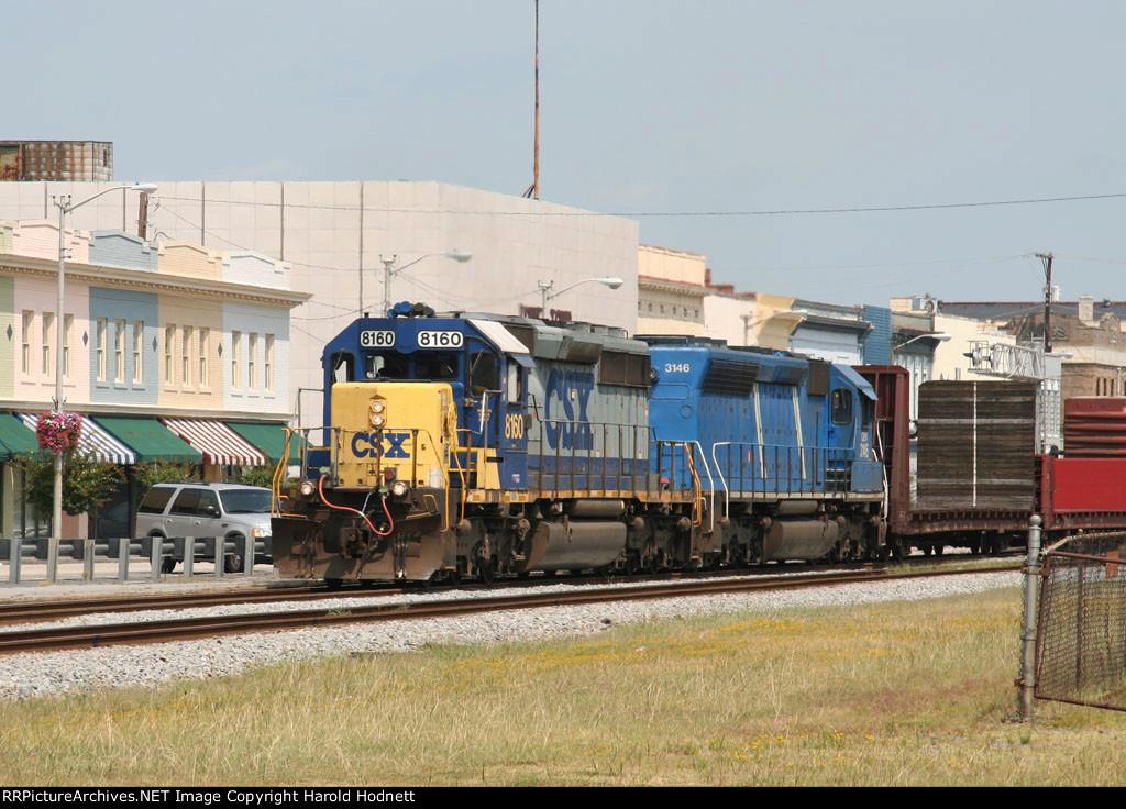 CSX 8160 leads a train southbound