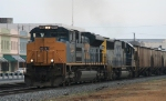 CSX 4842 leads a southbound grain train