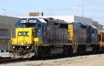CSX 6971 & 2371 lead train F017-05 through town