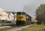 CSX 7312 leads a loaded grain train into town