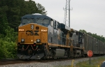 CSX 5476 leads train Q409 held north of town