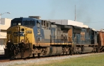 CSX 143 leads train Q451 through town