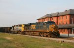 CSX 5202 & 8143 lead an empty coal train past the station