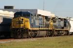 CSX 407 & 7328 lead train Q451 past Amtrak train 92