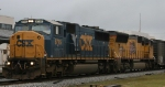 CSX 8745 leads a UP unit towards the yard on an overcast day
