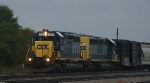 CSX 8875 leads train Q446 out of the yard on a drizzly morning