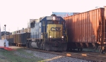 CSX 8586 heads north past a southbound freight