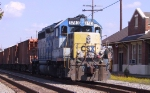 CSX 6783 idles with some ballast cars outside the station