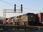 CSX 5118 leads a train past the signals