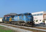 CSX 7358 & 8747 head north, past the station