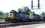 CSX 8112 & 8116 leads a train past the signals at Charlie Baker