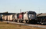 GCFX 3082 leads two other lease units and an empty CSX grain train northbound