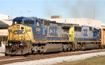 CSX 9048 leads a train southbound
