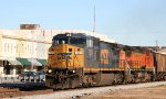 CSX 7325 & BNSF 812 lead a grain train southbound