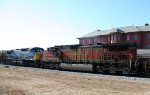 BNSF 4349 & CSX 9036 head northbound on an empty grain train