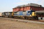 CSX 7640 & 7804 lead an empty grain train northbound
