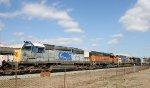 CSX 8237 & BNSF 7303 head northbound