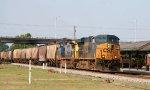 CSX 5278 leads an empty grain train northbound