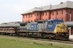 CSX 7858 leads a work train northbound