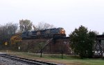 CSX 849 leads train Q300-09 northbound at sunset in a light rain