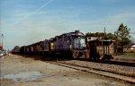 CSX 2526 leads a southbound train past the pickle plant