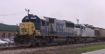 CSX 8514 leads a lease unit and a grain train southbound