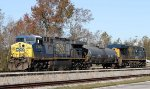 CSX 642 moves a single tank car with the help of CSX 845